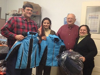 Brother Knights making a winter coats donation to Catholic Charities in 2014