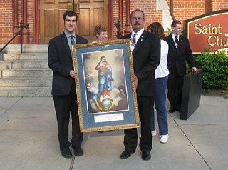 Brother Knights presenting a picture of Mary after the Immaculate Conception devotional at St. Joseph's